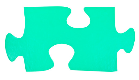 close fitting: one light green paper piece of jigsaw puzzle isolated on white background Stock Photo