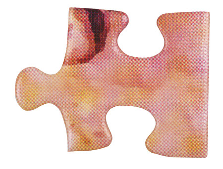 close fitting: cardboard pink piece of jigsaw puzzle close up isolated on white
