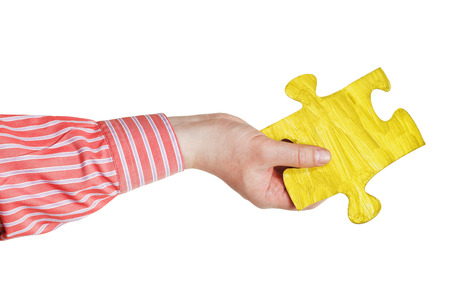 male hand with painted yellow puzzle piece isolated on white  photo