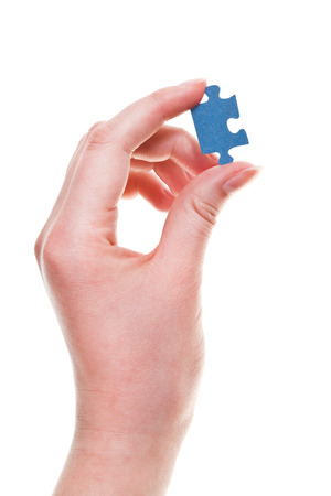 female arm with jigsaw puzzle piece isolated on white background photo