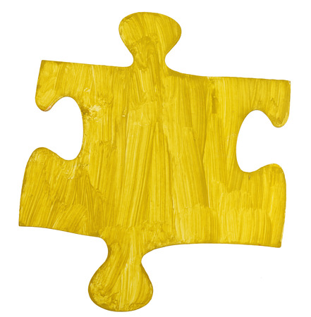 close fitting: one yellow painted paper piece of jigsaw puzzle isolated on white background