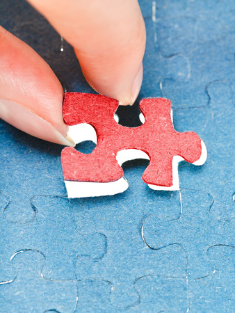 assembling the last red of puzzle in free space in assembled jigsaw puzzles photo