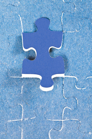 setting the last blue piece of puzzle in free space in assembled jigsaw puzzles photo