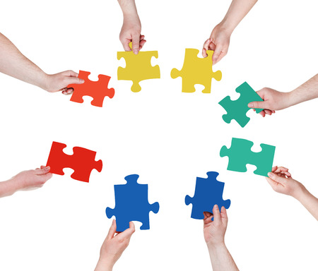 circle of people hands with puzzle pieces isolated on white background photo
