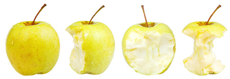 bitten apple and whole golden delicious apple isolated on white background