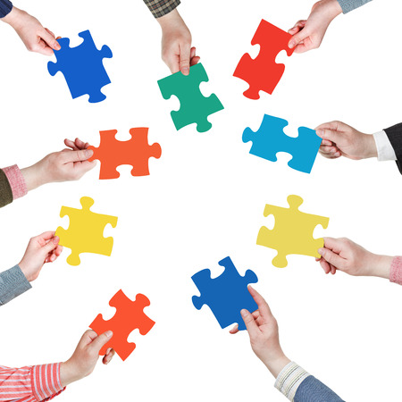 teamwork hands: set puzzle pieces in people hands in circle isolated on white background Stock Photo