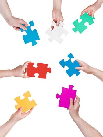 circle of people hands with different puzzle pieces isolated on white background photo