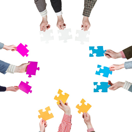 four sides with people hands holding puzzle pieces isolated on white background photo