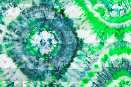 nodular: batik - abstract green floral pattern on silk fabric Stock Photo