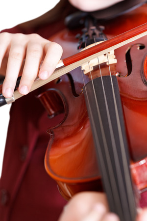 fiddlestick: girl plays on violin by bow close up