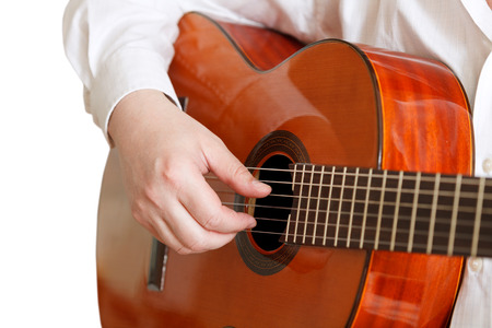 man plays on typical acoustic guitar close up isolated on white background photo