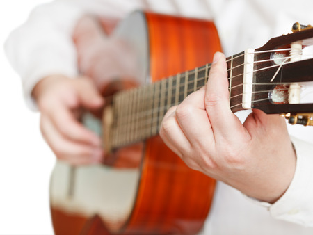 pegheads: man playing classical guitar close up isolated on white background Stock Photo
