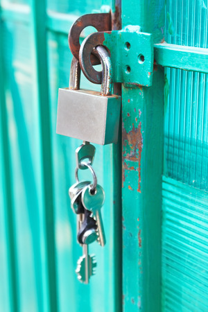 doorlock: padlock with bunch of keys hanging on the door