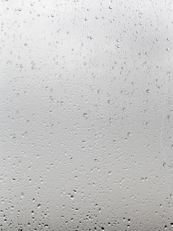 soppy: background from rain drops on window pane close up