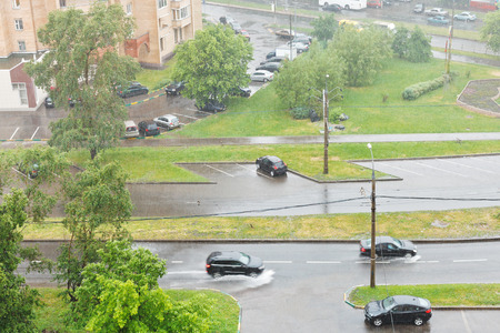 soppy: above view of urban street in pouring rain in summer day Stock Photo