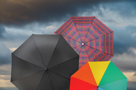 open umbrellas with storm grey clouds background photo