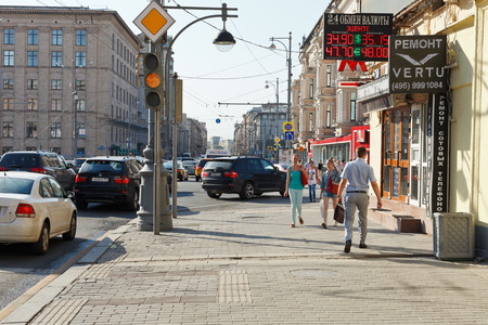 MOSCOW, RUSSIA - JUNE 3, 2014  wide sidewalk on Triumphalnaya Square of Tverskaya street in Moscow, Russia  Tverskaya is main street and existed as early as the 12th century
