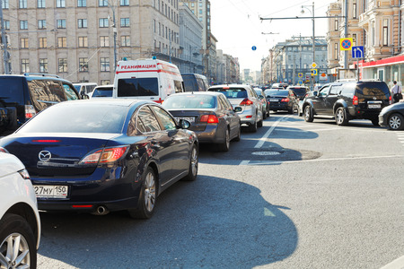 MOSCOW, RUSSIA - JUNE 3, 2014  traffic congestion on Tverskaya street in Moscow, Russia in summer evening  Tverskaya is main street and existed as early as the 12th century