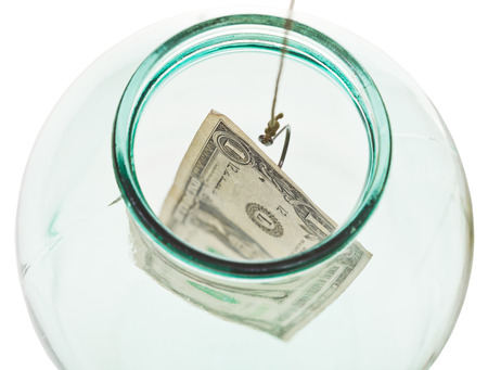 top view of catching the last dollar from glass jar isolated on white background photo