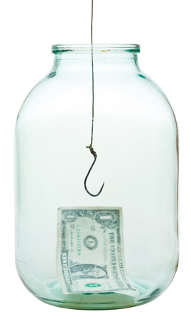 one dollar banknote on bottom of jar and fishhook isolated on white background photo
