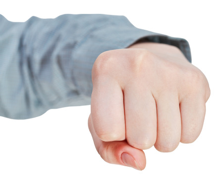 fist clenched: front view of fist - hand gesture isolated on white background Stock Photo