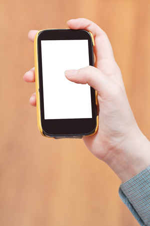 cut out screen of mobile phone in female hand photo