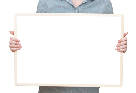 blank bulletin board in female hand isolated on white background photo