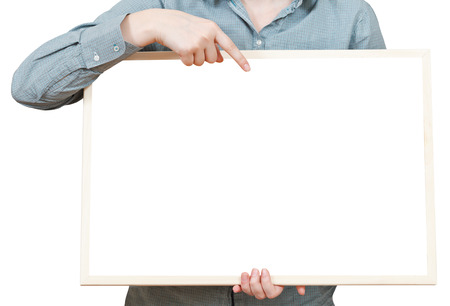 finger points on blank bulletin board in female hand isolated on white background photo