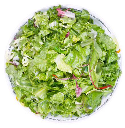 top view of fresh italian lettuce mix in bowl isolated on white background photo