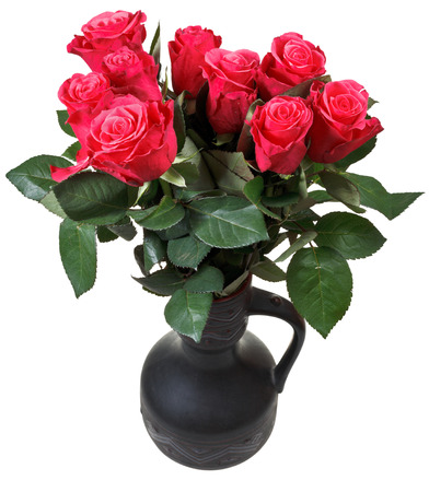 bouquet of red roses in black ceramic jug isolated on white background photo