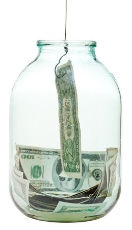 catching saving dollars from glass jar isolated on white background photo