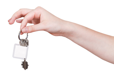key fob: hand with door keys and blank key fob isolated on white background