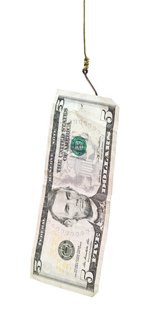 fishing with 5 dollars banknote bait on fishhook isolated on white background photo