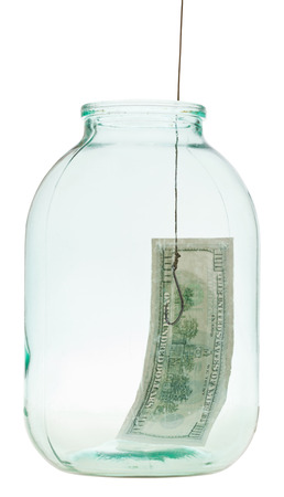 allurement: fishing out 100 dollars banknote from glass jar isolated on white background