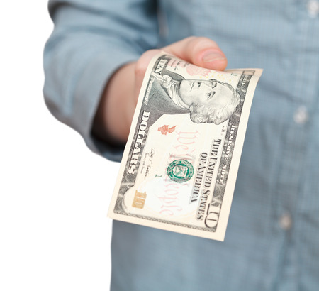 ten dollars banknote in hand close up photo