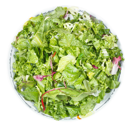 above view of fresh italian lettuce mix in bowl isolated on white background photo