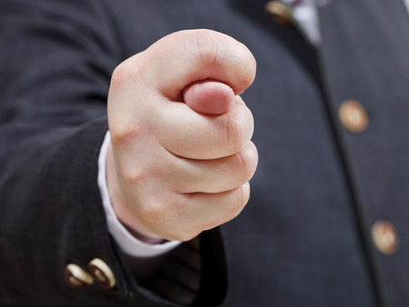 businessman holds fig sign close up - hand gesture photo