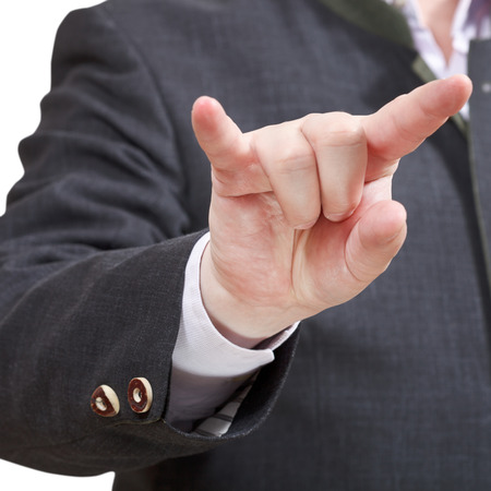 businessman shows horns fingers sign close up - hand gesture isolated on white background photo