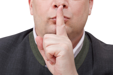 front view of male finger near lips - silence hand gesture isolated on white background photo