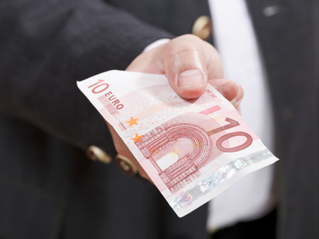 front view of ten euro banknote in male hand close up