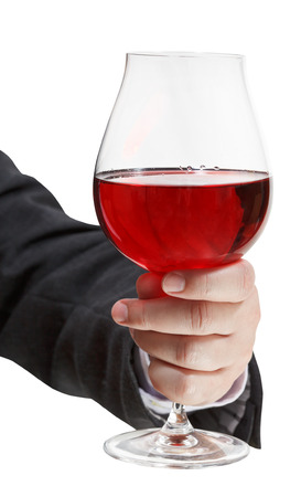 front view of red wine glass in businessman hand isolated on white background photo