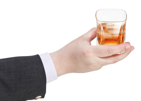 proposing a toast: whiskey with ice glass in businessman hand isolated on white background