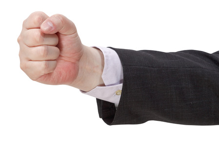 side view of clenched fist - hand gesture isolated on white background Stock Photo