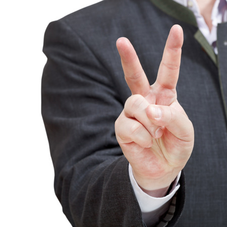 businessman shows victory sign close up - hand gesture isolated on white background photo