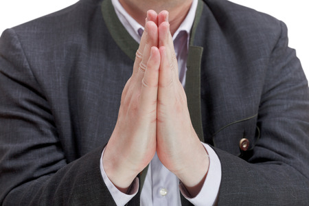 front view of businessman praying hands - hand gesture isolated on white background photo