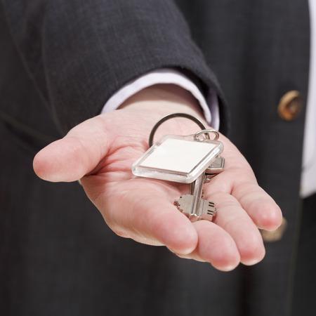 blank door keychain on businessman photo