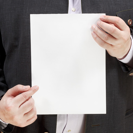 explanations: salesman holds blank sheet of paper in hands isolated on white background Stock Photo