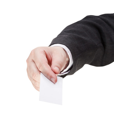 front view of blank business card in male hand isolated on white background photo