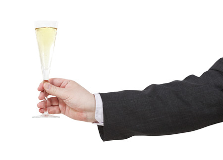 proposing a toast: side view of champagne glass in male hand isolated on white background Stock Photo