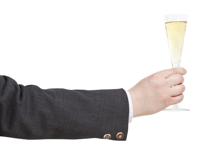 proposing a toast: side view of champagne glass in businessman hand isolated on white background